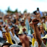 A picture of raised fists at a protest. (Credit: commons.wikipedia.org)